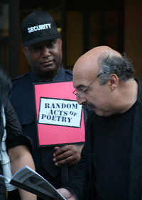 image of Carmeo Militano reading a poem to a security guard